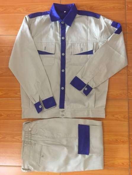 Đồng phục công nhân màu ngà viền xanh