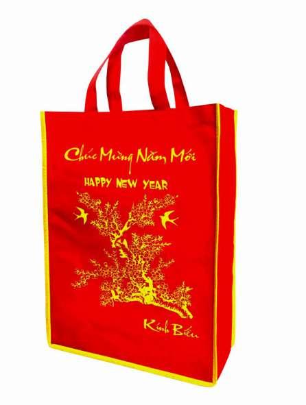 Túi vải không dệt màu đỏ viền vàng